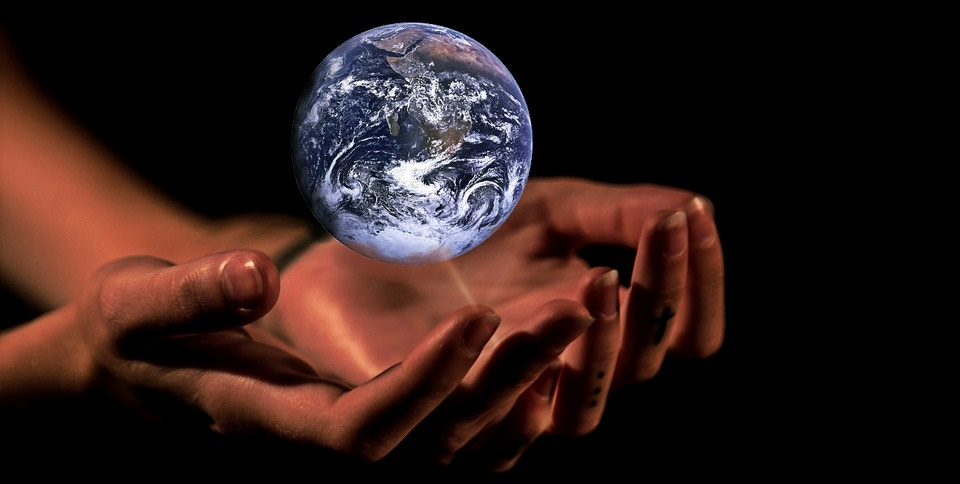 Hands caring for the planet